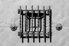 Guarded peephole on the massive metal door Stock Photos