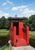 Guardhouse. Red, wooden, old guardhouse near the canal of fortress Bourtange Royalty Free Stock Photo