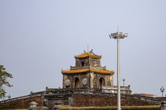 Guardhouse on Citadel of Hue in Vietnam. Guardhouse on wall around Citadel of Hue with copy space in blue skies in Hue, Vietnam stock photography
