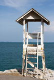 Guardhouse. White guardhouse on shore with sea and sky Stock Image