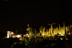 Guardián del tiempo. Alhambra Generalife`s Palace and its gardens illuminated by night Royalty Free Stock Photos