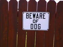 Guardi da del segno del cane Fotografia Stock