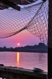 Tramonto e rete da pesca Fotografia Stock Libera da Diritti