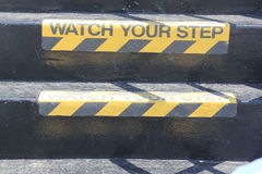 Guardi il vostro segno di punto sulle scale Fotografia Stock