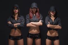 Guardia atractivo de tres muchachas Imagen de archivo libre de regalías