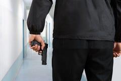 Guardia de seguridad Hands With Pistol Foto de archivo libre de regalías