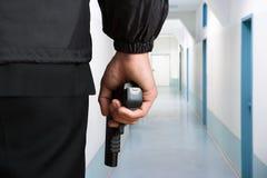 Guardia de seguridad Hands With Pistol Fotografía de archivo