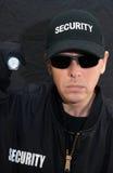 Guardia de seguridad Shines Flashlight At la cámara Imágenes de archivo libres de regalías