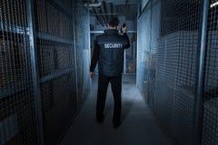 Guardia de seguridad Standing In The Warehouse Imagenes de archivo