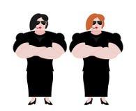 Guardia del corpo femminile Forte guardia della donna al night-club Vestito nero a Immagine Stock
