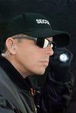 Guardia giurata Searches With Flashlight Immagini Stock Libere da Diritti