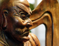 The Guardian. A wood carving of an ancient Japanese statue of a guardian monk used to ward off evil spirits royalty free stock image