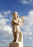 Guardian Angel. Prayer of an angel in white marble Stock Photography