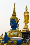 The guardian angel. Statue standing before a pagoda, Amphawa, Thailand Stock Photo