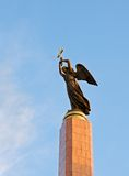 Guardian Angel. High in the sky over the city of Stavropol, the statue of an angel bearing a cross. This angel keeps the city from all ills Royalty Free Stock Photos
