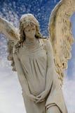 Guardian angel. Over a blue sky Stock Photos