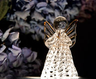 Guardian angel. Glass guardian angel with hydrangea stock images
