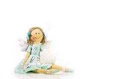 Guardian angel: isolated handmade doll with a white heart in her Stock Image