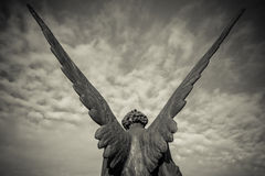 Guardian angel. Over sky  - black and white photo Stock Photography