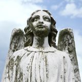 Guardian angel statue. In graveyard Stock Images