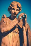 Guardian angel statue on blue sky vintage style. Guardian angel statue on blue sky - vintage style photo Royalty Free Stock Photo