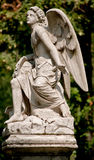 Guardian Angel statue in a cemetery outdoor Stock Photos