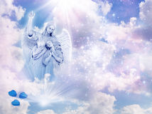 Guardian angel. An angel statue over mystical sky with divine light and stars royalty free stock photos