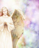 Guardian Angel. Traditional angel illustration on pastel bokeh background Stock Photos