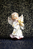 Guardian angel. White Guardian angel with a gold stars on a dark background with a golden pattern Stock Photography