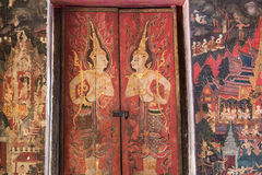 Guardian angles. Water color painting of guardian angles on wooden door in an ancient temple in Bangkok, Thailand Stock Images