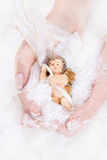 Guardian or Christmas angel in the hands Royalty Free Stock Photos