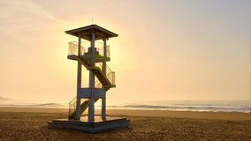 The guardian of the coast. Architecture chromatic scenery relaxation Sunset Beach sky ray Sunup sea Guardian watchtower Stock Photo