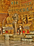 Guardian daemon dogs on entrance of kings palace Bangkok, Thailand Royalty Free Stock Photos