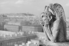 Guardian demon. The best known chimera of Notre Dame de Paris Stock Photography