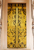 Guardian door. Thai art painting door with golden color it's public object in public place available to publish Royalty Free Stock Photography