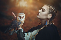 Guardian of the forest with familiar owl Royalty Free Stock Images