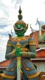 Guardian giant at Wat Arun Temple of dawn Stock Photos
