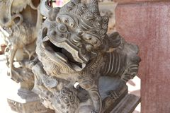 Guardian lion. A Guardian lion in front the the Emperor`s Palace in Beijing stock image
