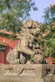 Guardian Lion in front of an ornamented pavilion at Yonghe Lamasery, also known as Lama Temple, Beijing, China. BEIJING-SEPT. 19, 2009. Guardian Lion in front of Stock Photo