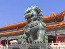 Guardian Lion in front of pavilion at Palace Museum, Beijing, China. BEIJING-AUGUST 28, 2016. Guardian Lion in front of pavilion at Palace Museum. It was listed Stock Photos