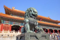 Guardian Lion in front of pavilion at Palace Museum, Beijing, China. BEIJING-OCT. 23, 2016. Guardian Lion in front of pavilion at Palace Museum. It was listed Royalty Free Stock Photography