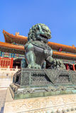 Guardian Lion in front of pavilion at Palace Museum, Beijing, China. BEIJING-OCT. 23, 2016. Guardian Lion in front of pavilion at Palace Museum. It was listed Royalty Free Stock Photos