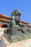 Guardian Lion in front of pavilion at Palace Museum, Beijing, China. BEIJING-OCT. 23, 2016. Guardian Lion in front of pavilion at Palace Museum. It was listed Stock Image