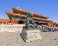 Guardian Lion in front of pavilion at Palace Museum, Beijing, China Royalty Free Stock Images