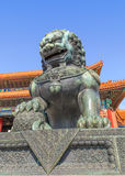 Guardian Lion in front of pavilion at Palace Museum, Beijing, China. BEIJING-OCT. 23, 2016. Guardian Lion in front of pavilion at Palace Museum. It was listed Stock Photography