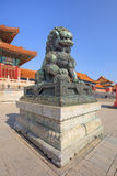 Guardian Lion in front of pavilion at Palace Museum, Beijing, China. BEIJING-OCT. 23, 2016. Guardian Lion in front of pavilion at Palace Museum. It was listed Stock Photo