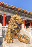 Guardian Lion in front of pavilion at Palace Museum, Beijing, China. BEIJING-OCT. 23, 2016. Guardian Lion in front of pavilion at Palace Museum. It was listed Royalty Free Stock Image