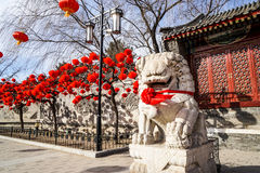 A Guardian Lion in a Historic Traditional Garden of Beijing, China in winter, during Chinese New Year Royalty Free Stock Images