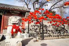 A Guardian Lion in a Historic Traditional Garden of Beijing, China in winter, during Chinese New Year Royalty Free Stock Image