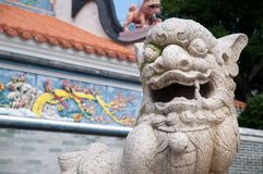 Guardian lion outside Pak Tai Temple on Cheung Chau, Hong Kong. CHEUNG CHAU, HONG KONG - MAY 6, 2012 - Guardian lion outside Pak Tai Temple on Cheung Chau, Hong Stock Images